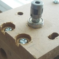 The z-axis coupling and bearing at the top of the z-axis assembly